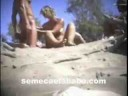 nude_beach_couples_mutual_masturbation