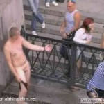 a drunk East European naked guy in public fountain