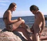 Jerking off for smoking girl on the beach