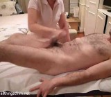 Female massage therapist gives Simon full release
