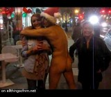 Naked guy poses nude with 2 cuties on the street