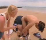 British girl gets 3 guys naked in beach strip dare