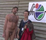 French nudist poses for pics with woman