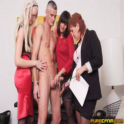 3 women inspect nude man