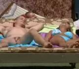Naked guy surprises hot female sun bather