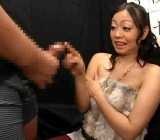 Busty Japanese woman watches guy jerk off up close2