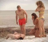 Man strips naked in front of two MILFs on beach