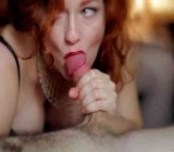 MILF in black corset gives a CFNM blowjob