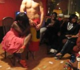 Black MILF feels up naked & hung male stripper