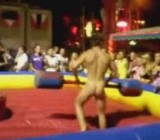 Girls watch 2 nude guys fight with inflateables
