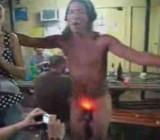 Women at the bar laugh at naked Japanese party boy