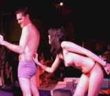 Sexy chick dances strips & whips guy on stage