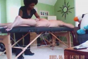 Black esthetician giving naked guy butt waxing