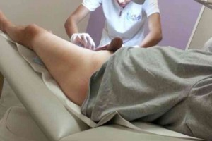 Cute esthetician handles cock during waxing job