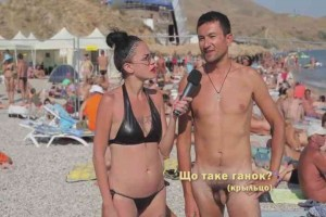 Russian hottie interviews naked chicks & guys on nude beach5