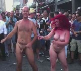 Girl films four naked people dancing in the street