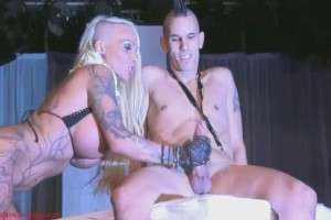 Tattooed busty stripper strips guy & jerks guy off