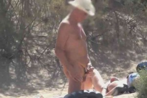 Busty MILF watches 2 guys jerk off on nude beach