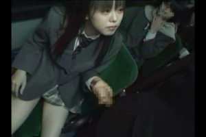 Japanese schoolgirl jerks off male passenger on the bus