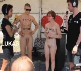 Crowd of naked people race outside at Rokskilde festival