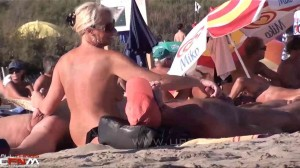 MILF yanks on two cocks & smiles while watched on nude beach