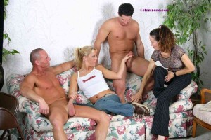 Two girls lounging with two naked and erect men