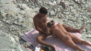 MILF on nude beach jerks sucks & watches bf jack off
