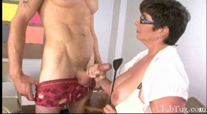 Busty MILF teacher jacks off a well fit male