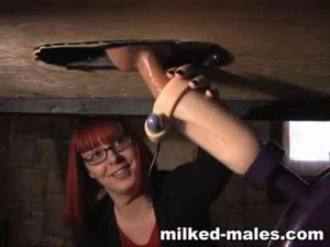 Redhead uses milking machine & her hands on huge dick