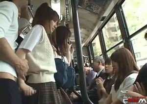 Japanese girl jerks off a stranger in front of girlfrends on public bus