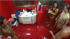 Hot brunette in bikini showers with naked guys on hidden camera