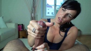 Brunette MILF gives a slow sophisticated twisting handjob