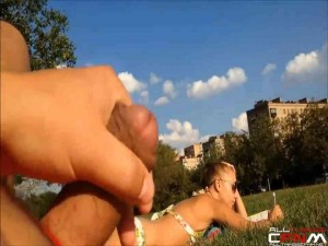 Gorgeous blonde in bikini watches man jacking off in park