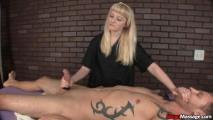 Annoyed blonde masseuse gives CFNM cruel happy ending